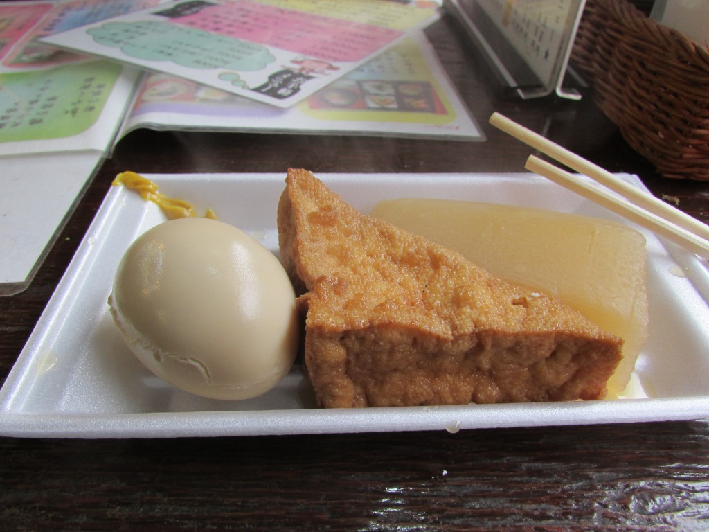 Oden - egg, tofu and daikon radish with mustard.