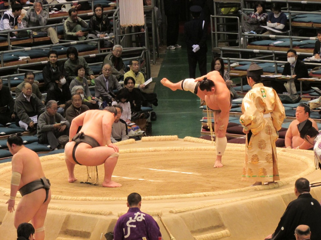 Don't fall over, sumo wrestler!