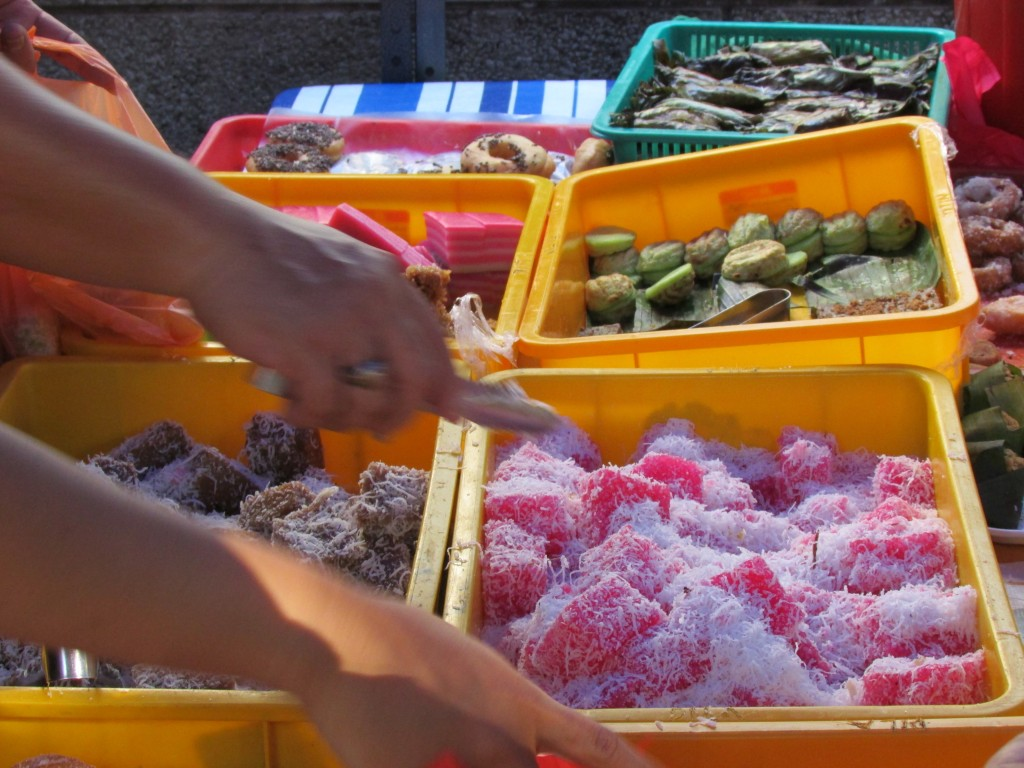 Malay sweets -- the ones in front are like chewy jellys covered in coconut.