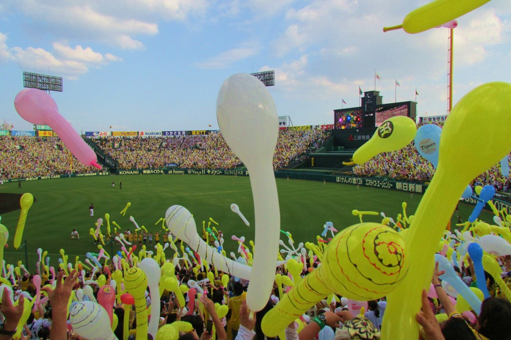 Balloons being let off into the sky at a Hanshin Tigers game.