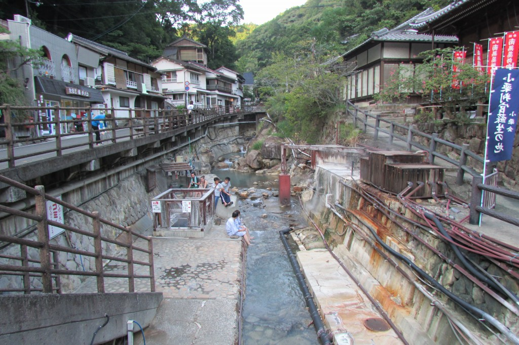The river running through Yunomine Onsen. On the left is a hotspring to boil eggs, chestnuts and sweet potatoes which can be purchased in the shop.