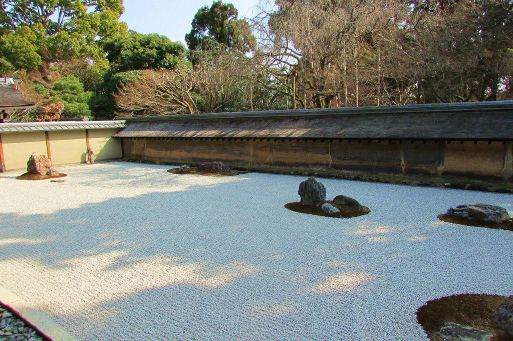 Ryoanji's zen garden is protected on three sides by an earthen wall, allowing viewing from only one side.